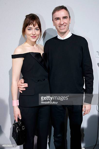 Dakota Johnson and Fashion Designer Raf Simons pose backstage after the Christian Dior show as part of the Paris Fashion Week Womenswear Fall/Winter...