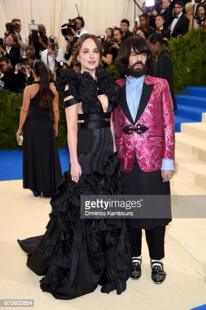 Dakota Johnson and Gucci Creative Director Alessandro Michele attend the 'Rei Kawakubo/Comme des Garcons Art Of The InBetween' Costume Institute Gala...