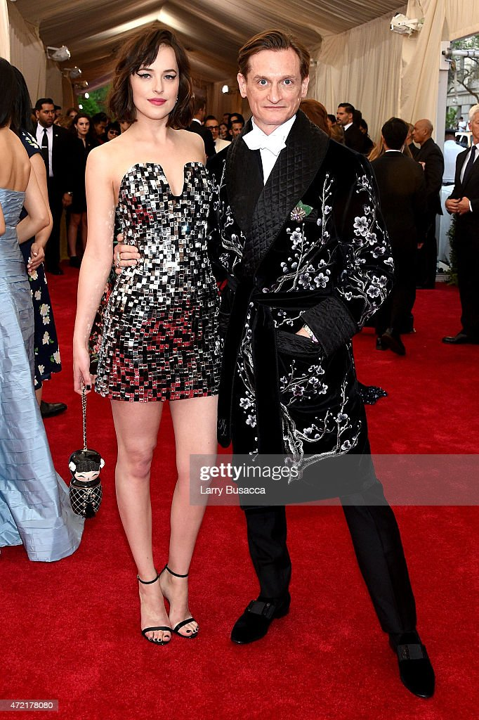 Dakota Johnson (L) and Hamish Bowles attend the 'China: Through The Looking Glass' Costume Institute Benefit Gala at the Metropolitan Museum of Art on May 4, 2015 in New York City.