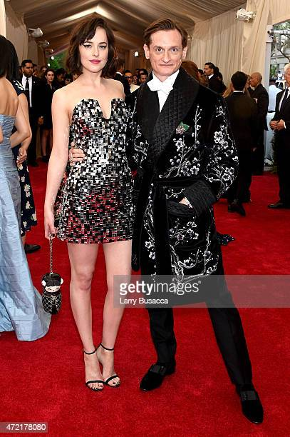 Dakota Johnson and Hamish Bowles attend the China Through The Looking Glass Costume Institute Benefit Gala at the Metropolitan Museum of Art on May 4...