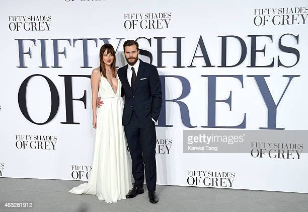 Dakota Johnson and Jamie Dornan attend the UK Premiere of Fifty Shades Of Grey at Odeon Leicester Square on February 12 2015 in London England