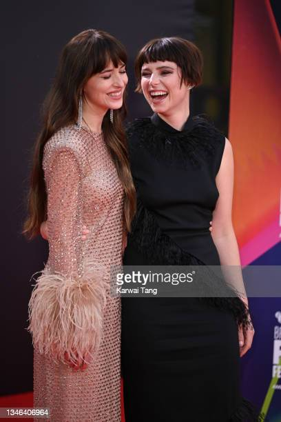 """Dakota Johnson and Jessie Buckley attend """"The Lost Daughter"""" UK Premiere during the 65th BFI London Film Festival at The Royal Festival Hall on..."""