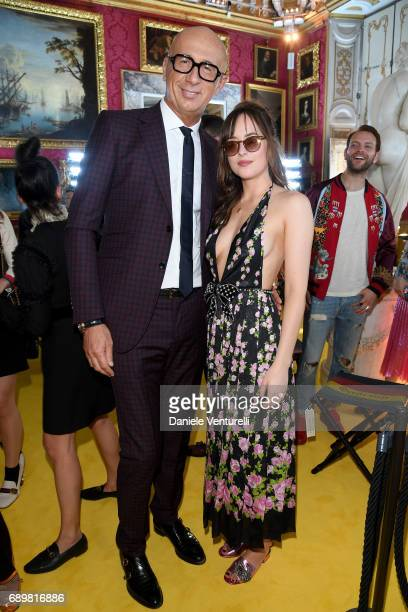 Dakota Johnson and Marco Bizzarri attend the Gucci Cruise 2018 fashion show at Palazzo Pitti on May 29 2017 in Florence Italy