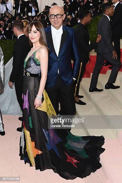 "Dakota Johnson and Marco Bizzarri attend the ""Manus x Machina: Fashion In An Age Of Technology"" Costume Institute Gala at Metropolitan Museum of Art..."