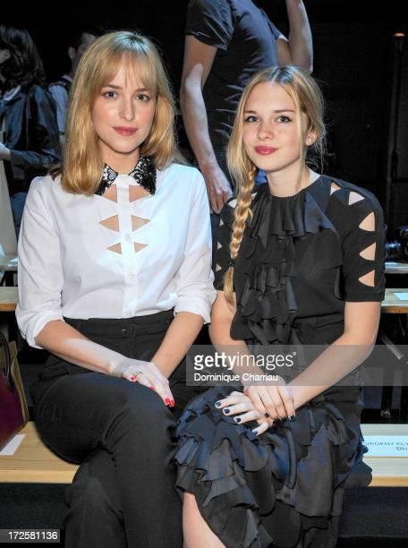 Dakota Johnson and Stella Banderas attend the ViktorRolf show as part of Paris Fashion Week HauteCouture Fall/Winter 20132014 at la Gaite Lyrique on...