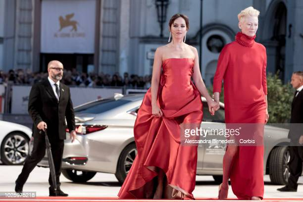 Dakota Johnson and Tilda Swinton walk the red carpet ahead of the 'Suspiria' screening during the 75th Venice Film Festival at Sala Grande on...