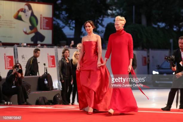 Dakota Johnson and Tilda Swinton walks the red carpet ahead of the 'Suspiria' screening during the 75th Venice Film Festival at Sala Grande on...