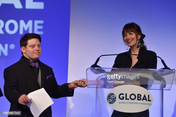 Dakota Johnson and Zack Gottsagen at the Global Down Syndrome Foundation 10th anniversary BBBY fashion show at Sheraton Denver Downtown Hotel on...