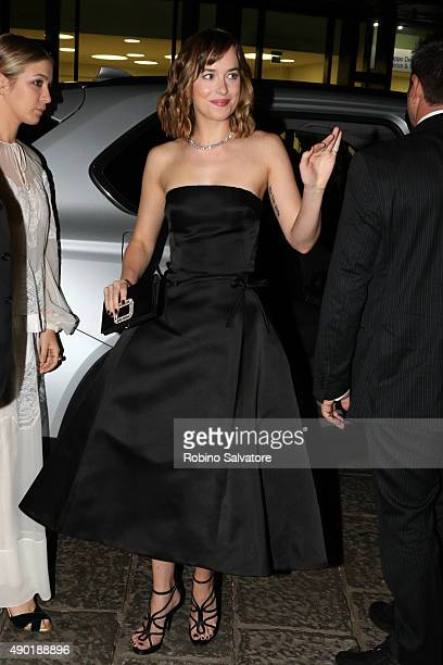 Dakota Johnson arrives at amfAR Milano 2015 at La Permanente on September 26 2015 in Milan Italy