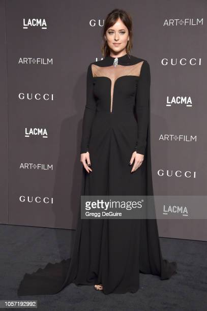 Dakota Johnson arrives at the 2018 LACMA Art Film Gala at LACMA on November 3 2018 in Los Angeles California