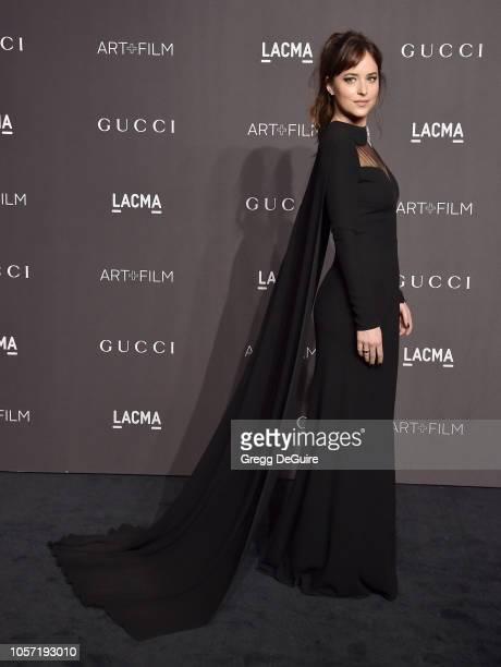 Dakota Johnson arrives at the 2018 LACMA Art Film Gala at LACMA on November 3 2018 in Los Angeles California