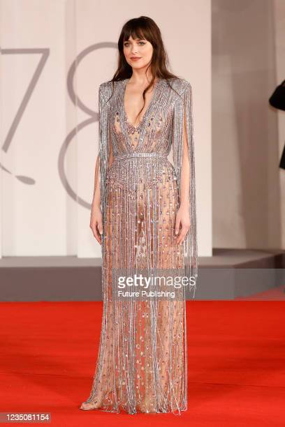 Dakota Johnson arrives on the red carpet for 'The Lost Daughter' during the 78th Venice International Film Festival in Venice, Italy.
