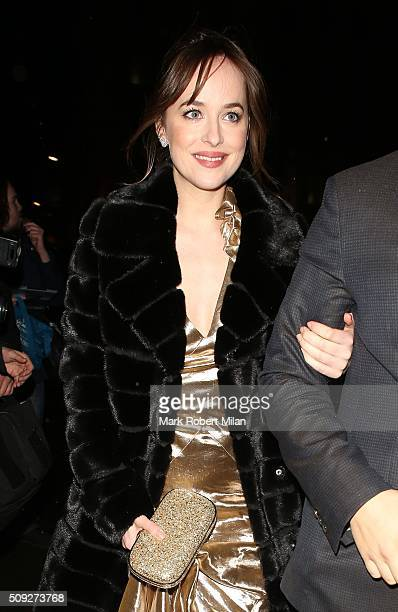Dakota Johnson attending Vogue 100: A Century of Style exhibition opening reception, National Portrait Gallery on February 9, 2016 in London, England.