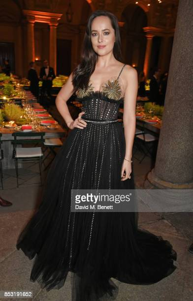 Dakota Johnson attends a private dinner hosted by Livia Firth following the Green Carpet Fashion Awards Italia at Palazzo Marino on September 24 2017...