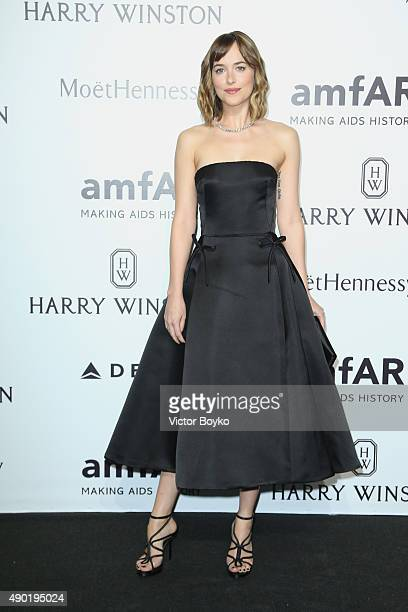 Dakota Johnson attends amfAR Milano 2015 at La Permanente on September 26 2015 in Milan Italy