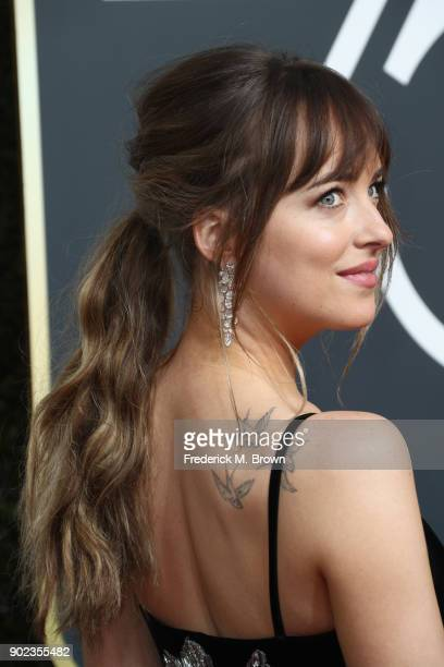Dakota Johnson attends The 75th Annual Golden Globe Awards at The Beverly Hilton Hotel on January 7, 2018 in Beverly Hills, California.