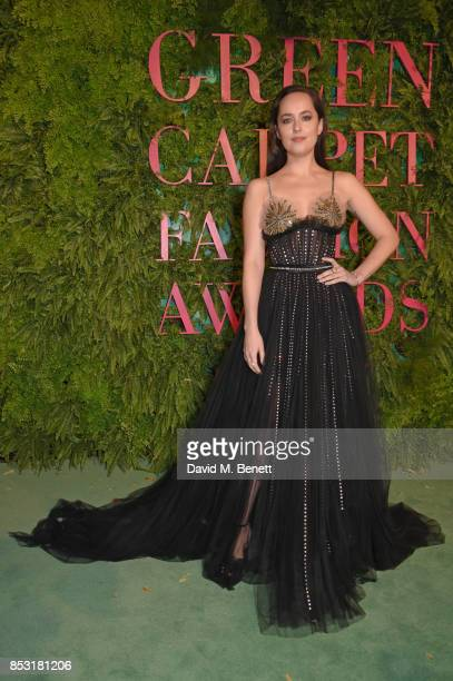 Dakota Johnson attends the Green Carpet Fashion Awards Italia wearing Gucci for the Green Carpet Challenge at Teatro Alla Scala on September 24 2017...