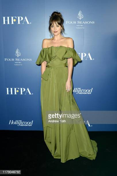 Dakota Johnson attends The Hollywood Foreign Press Association and The Hollywood Reporter party at the 2019 Toronto International Film Festival at...