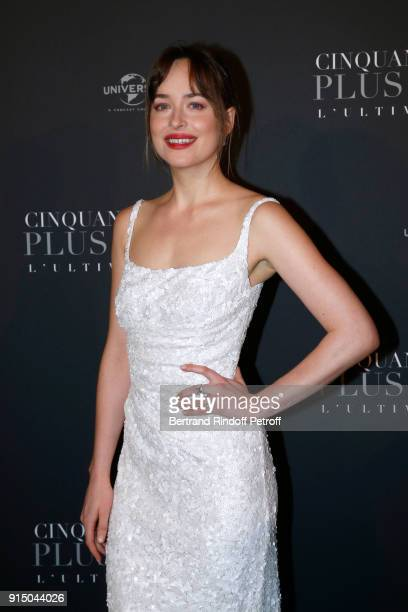 Dakota Johnson dressed in Prada attends the 'Fifty Shades Freed 50 Nuances Plus Clair' Paris Premiere at Salle Pleyel on February 6 2018 in Paris...