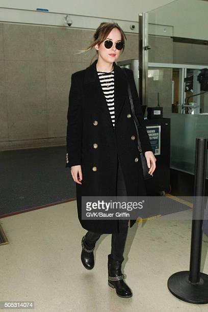 Dakota Johnson is seen at LAX on January 16 2016 in Los Angeles California