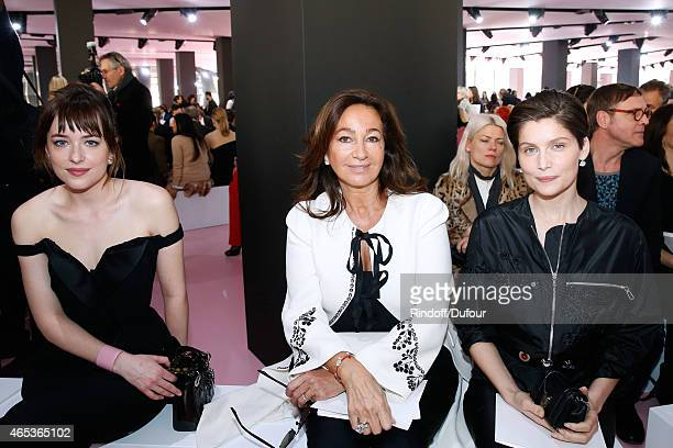 Dakota Johnson Katia Toledano and Laetitia Casta attend the Christian Dior show as part of the Paris Fashion Week Womenswear Fall/Winter 2015/2016 on...