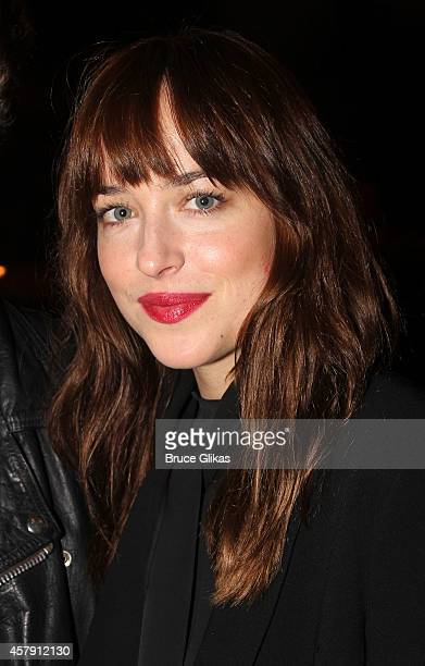 Dakota Johnson poses at The Opening Night of The Last Ship on Broadway at The Neil Simon Theatre on October 26 2014 in New York City