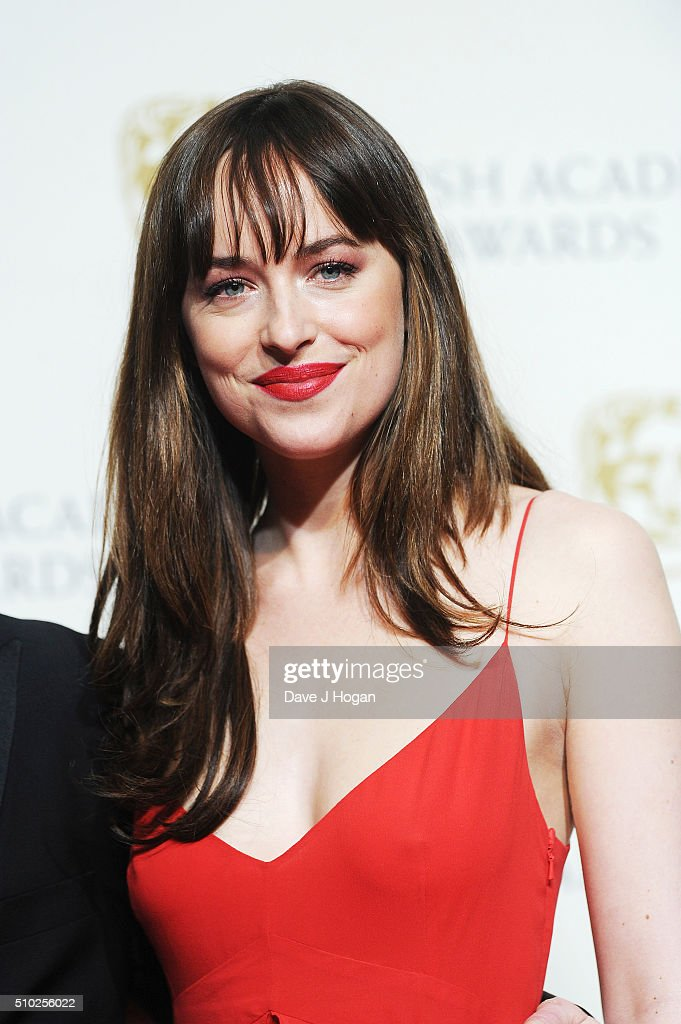 Dakota Johnson poses in the winners room at the EE British Academy Film Awards at The Royal Opera House on February 14, 2016 in London, England.
