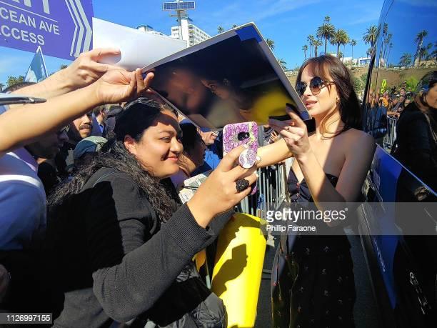 Dakota Johnson signs autographs at the 2019 Film Independent Spirit Awards on February 23 2019 in Santa Monica California