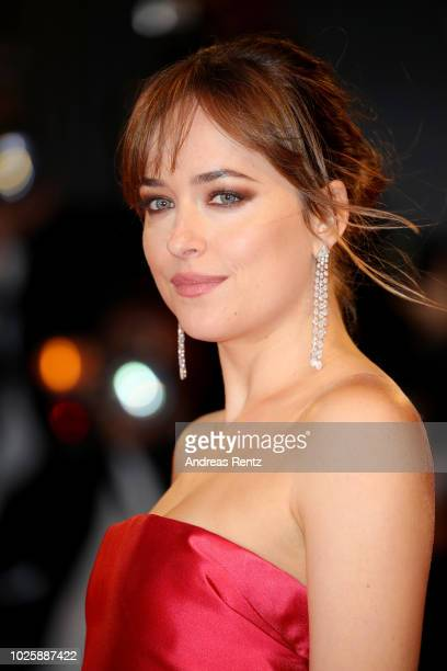 Dakota Johnson walks the red carpet ahead of the 'Suspiria' screening during the 75th Venice Film Festival at Sala Grande on September 1 2018 in...