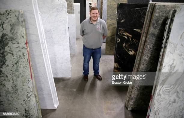 Dakota Lotz who works in Business Development for Divine Stoneworks in the new Metro West Design Center in Ashland MA poses for a portrait on Aug 1...