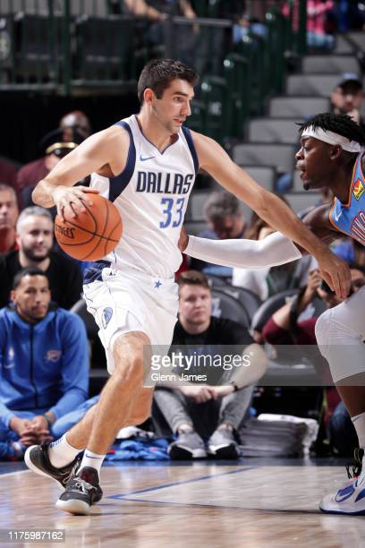 Dakota Mathias of the Dallas Mavericks handles the ball during a preseason game on October 14 2019 at the American Airlines Center in Dallas Texas...