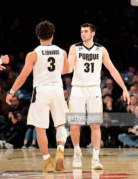 Dakota Mathias of the Purdue Boilermakers is congratulated by his teammate Carsen Edwards against the Penn State Nittany Lions during the semifinals...