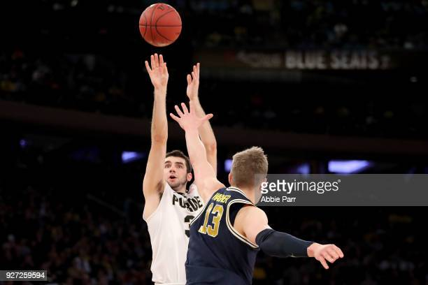 Dakota Mathias of the Purdue Boilermakers takes a shot against Moritz Wagner of the Michigan Wolverines in the second half during the championship...