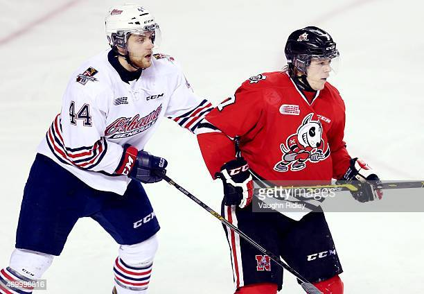 Dakota Mermis of the Oshawa Generals battles with Mikkel Aagaard of the Niagara IceDogs during Game 4 of the Eastern Conference SemiFinals at the...