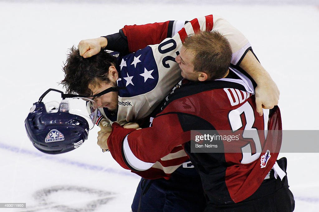 Dakota Odgers #26 of the Vancouver Giants punches Tri-City Americans Maxwell James' #20 helmet off during the second period of their WHL game at the Pacific Coliseum on October 16, 2015 in Vancouver, British Columbia, Canada.