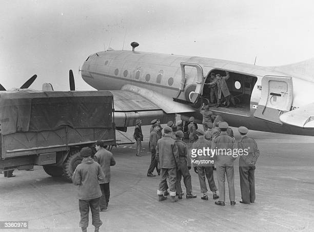 Dakota plane being unloaded in the British zone of Germany during the Berlin Blockade and subsequent airlift