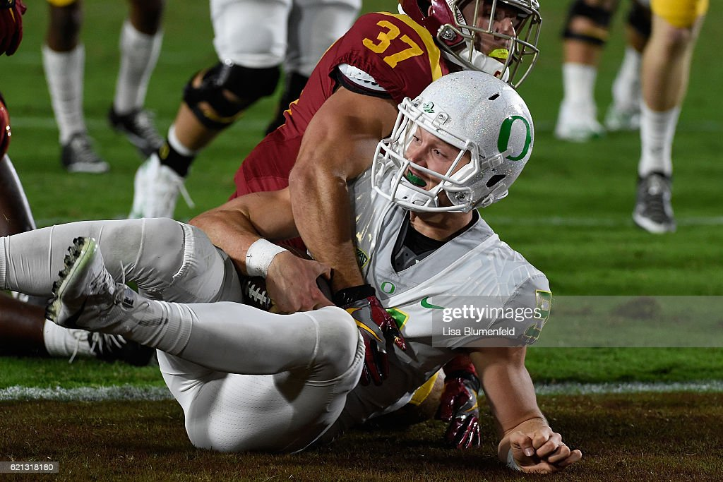 Dakota Prukop #9 of the Oregon Ducks scores a touchdown in the fourth quarter against the USC Trojans at Los Angeles Memorial Coliseum on November 5, 2016 in Los Angeles, California.