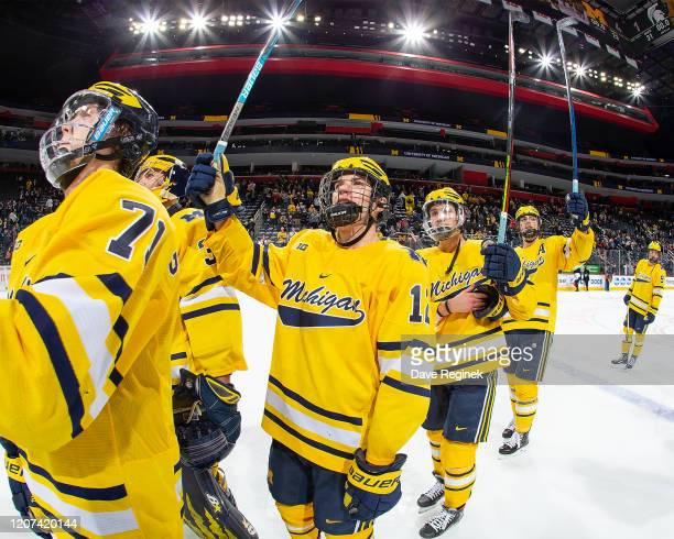 Dakota Raabe of the Michigan Wolverines as teammates salute the fans after the annual NCAA hockey game against the Michigan State Spartans during the...