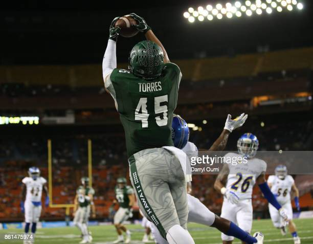 Dakota Torres of the Hawaii Rainbow Warriors leaps and makes a reception in the end zone to score a touchdown during the second quarter of the game...