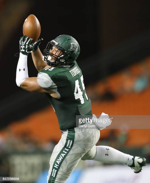 Dakota Torres of the Hawaii Rainbow Warriors manages to hold on to the ball in the third quarter of the game against the Western Carolina Catamounts...