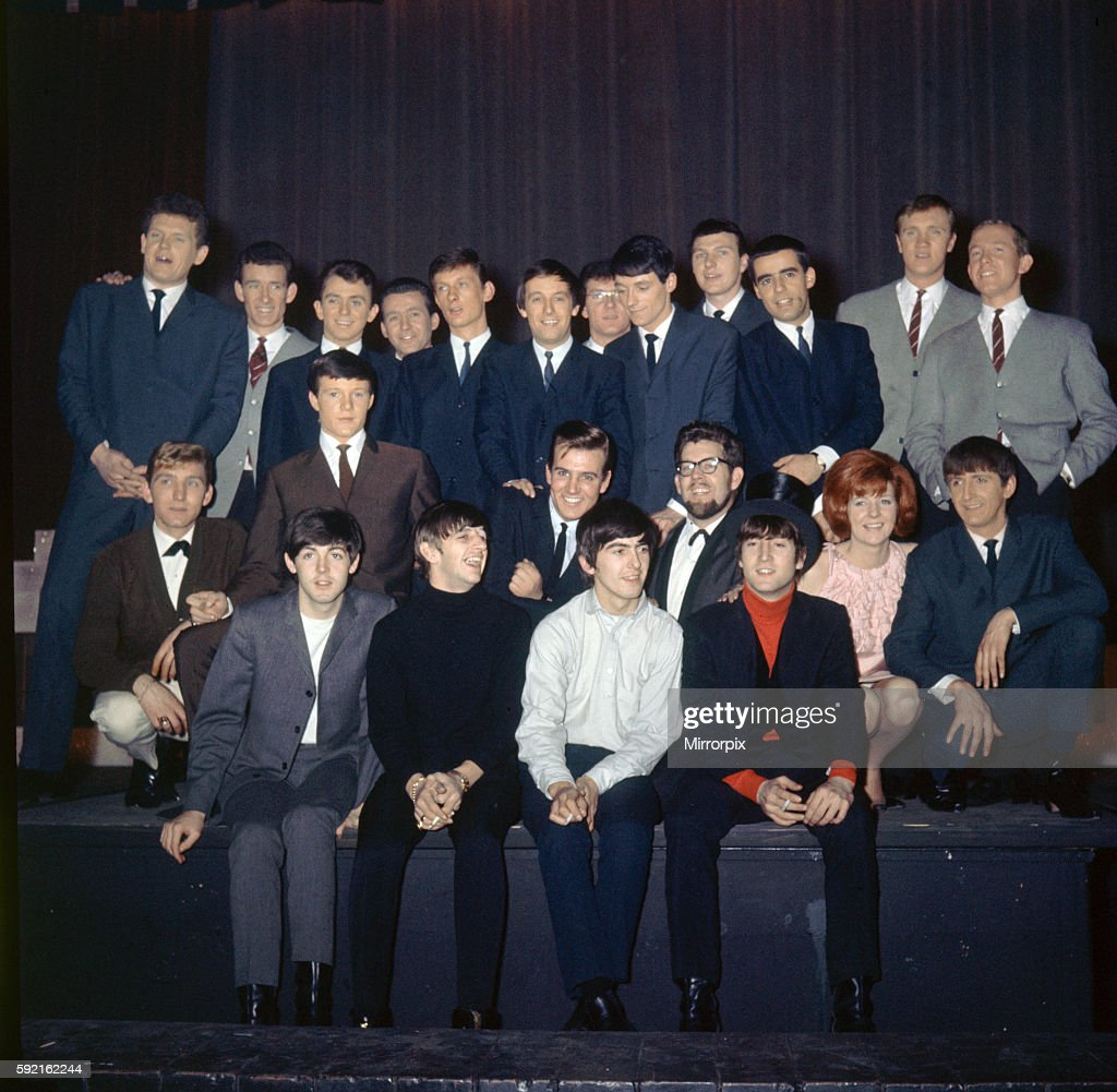 the beatles pose with some of the guest performers before rehearsal
