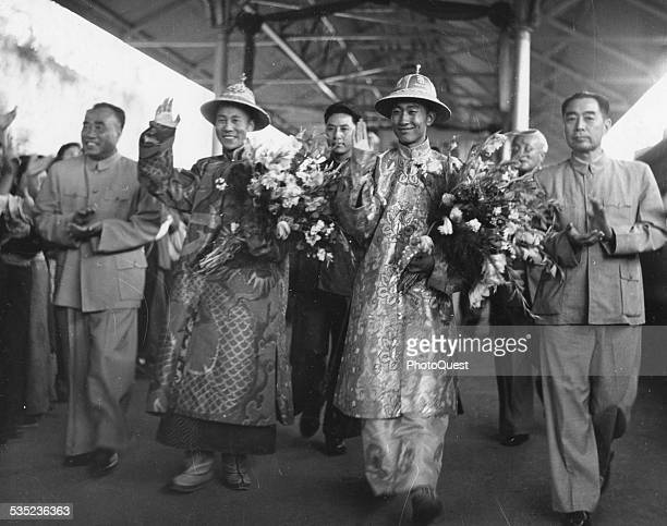 Dalai Lama and Panchen Ngoerhtehni arrive at the Peking Station Peking China September 1954 Front row left to right Chu Teh ViceChairman of the...