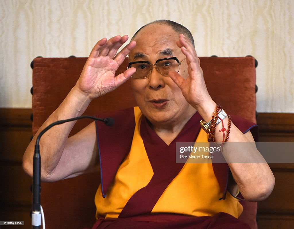 Dalai Lama gestures during a meeting with the Milan Archibishop Angelo Scola on October 20, 2016 in Milan, Italy. The Dalai Lama spiritual leader of Tibetan Buddhism, begins today the first of a three-day visit and spiritual meetings in Milan.
