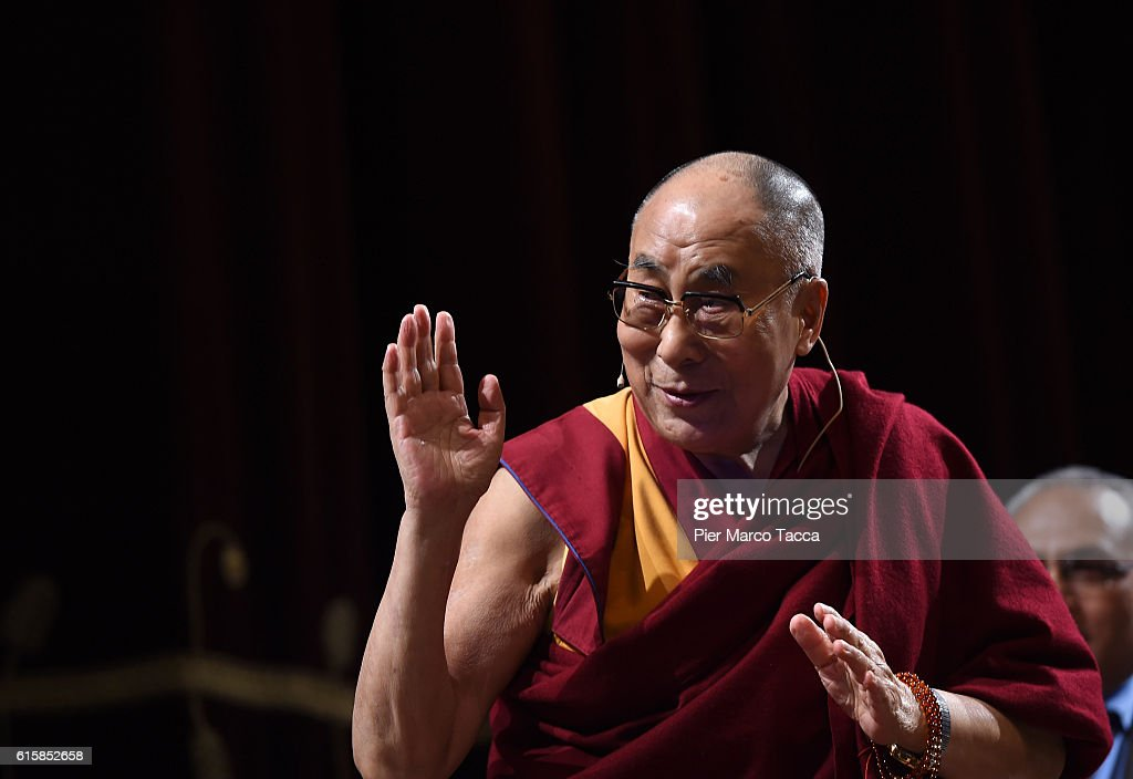 Dalai Lama gestures during the ceremony for honorary citizenship, during the meeting organized by the University Bicocca to the Arcimboldi theater on October 20, 2016 in Milan, Italy. The Dalai Lama spiritual leader of Tibetan Buddhism, starts today the first of a three-day visit and spiritual meetings in Milan.