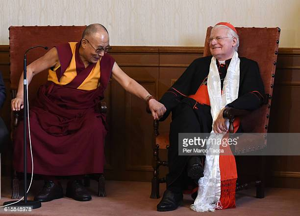 Dalai Lama gestures with Milan Archibishop Angelo Scola during a meeting with the Archbishop on October 20 2016 in Milan Italy The Dalai Lama...