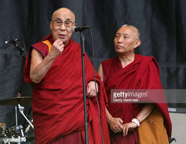 Dalai Lama gives a talk on the pyramid stage during the Patti Smith performance at the Glastonbury Festival at Worthy Farm Pilton on June 28 2015 in...