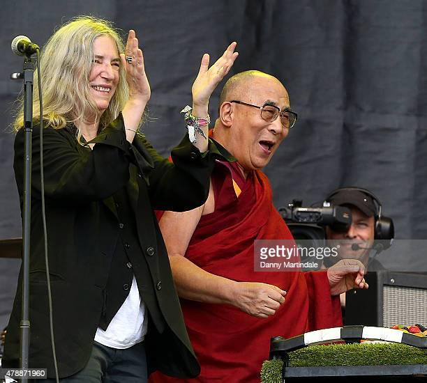 Dalai Lama is given a birthday cake during his a talk on the pyramid stage during Patti Smith's performance at the Glastonbury Festival at Worthy...