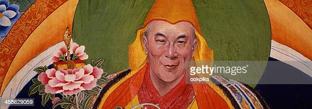 dalai lama mural portrait in iconic style - dalai lama stock pictures, royalty-free photos & images