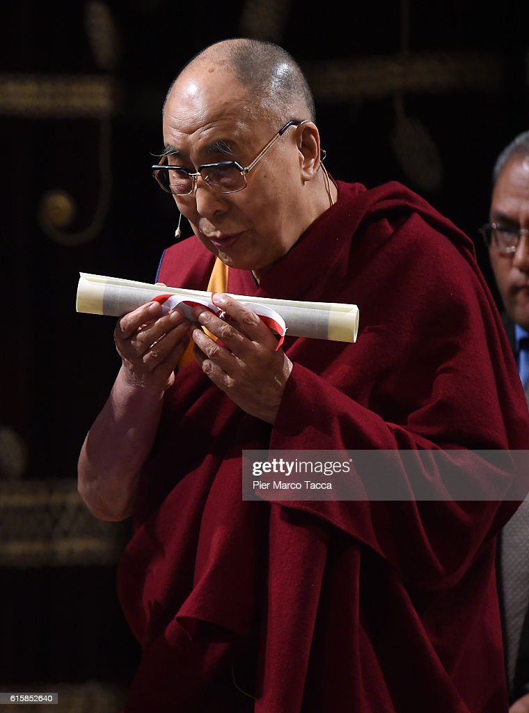 Dalai Lama receives the certificate of honorary citizenship at the ceremony for honorary citizenship, during the meeting organized by the University Bicocca to the Arcimboldi theater on October 20, 2016 in Milan, Italy. The Dalai Lama spiritual leader of Tibetan Buddhism, starts today the first of a three-day visit and spiritual meetings in Milan.