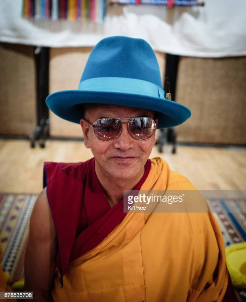 Dalai Lama's Gyuto Monk wears the photographers fashion hat during a recording in Rak studios to record an album ahead of their 'Open Minds Loving...